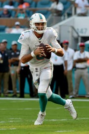 Miami Dolphins quarterback Brock Osweiler (8) throws a pass Chicago Bears during the second half at Hard Rock Stadium.