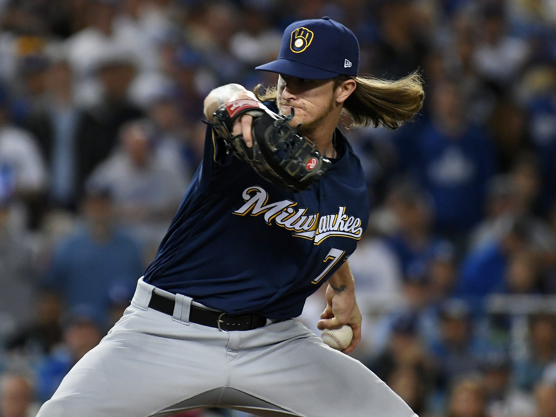 NLCS Game 4: Brewers relief pitcher Josh Hader throws a pitch in the eighth inning .