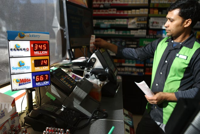 A worker processes lottery tickets on Oct. 16, 2018, in Los Angeles.