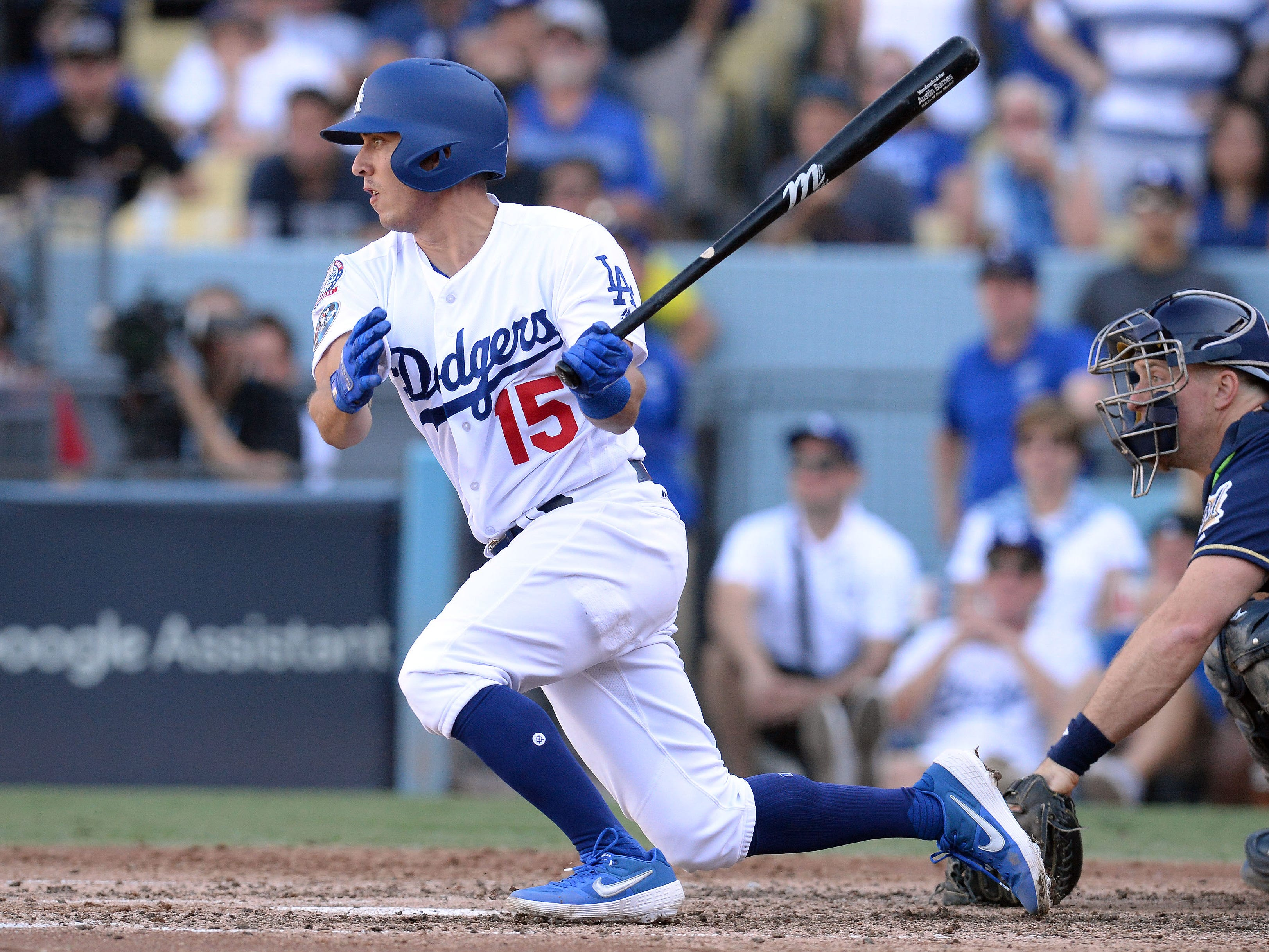 NLCS Game 5: Dodgers catcher Austin barnes hits an RBI single in the fifth inning.