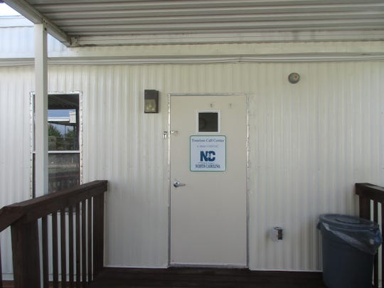 A guided walk through a series of security fences leads to a pair of trailers; one processes outgoing tourist mailings, the other is where the phone staff works.