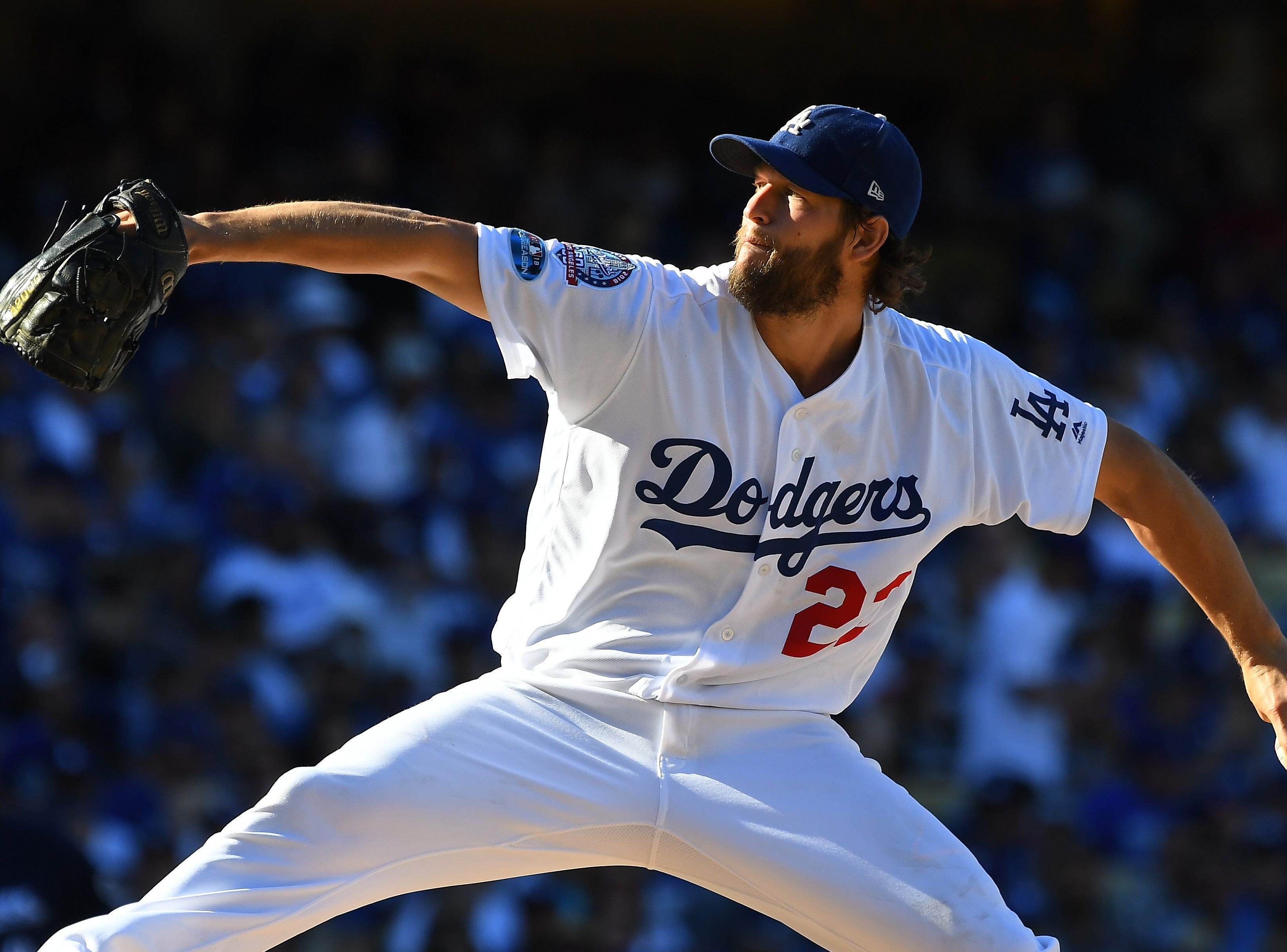 NLCS Game 5: Clayton Kershaw throws a pitch in the fifth inning.