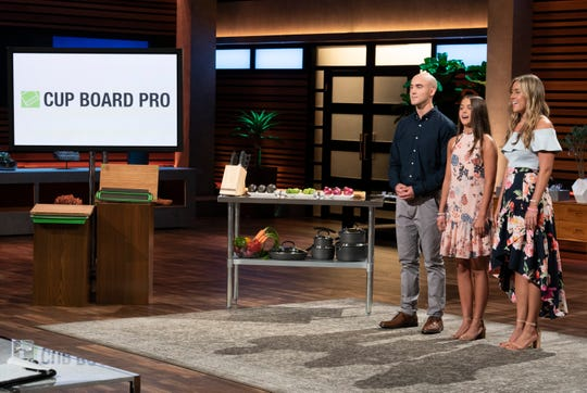 """Christian, Keira and Kaley Young, siblings from Long Island, N.Y., present Cup Board Pro, a kitchen product from their late father, a New York City firefighter. His dream was to pitch it on """"Shark Tank,"""" but he died before he could."""