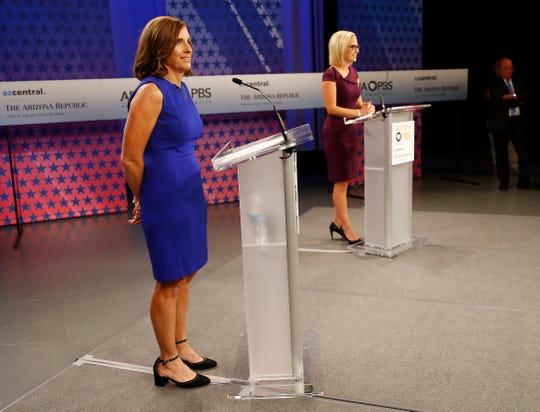 U.S. Senate candidates, U.S. Rep. Martha McSally, R-Ariz., left, and U.S. Rep. Kyrsten Sinema, D-Ariz., prepare their remarks in a television studio prior to a televised debate, Monday, Oct. 15, 2018, in Phoenix. Both ladies are seeking to fill the seat of U.S. Sen. Jake Flake, R-Ariz., who is retiring. (AP Photo/Matt York) ORG XMIT: AZMY106