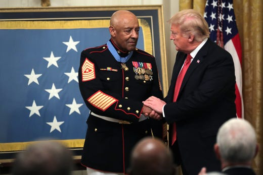 President Trump congratulates Canley after presenting him the Medal of Honor.
