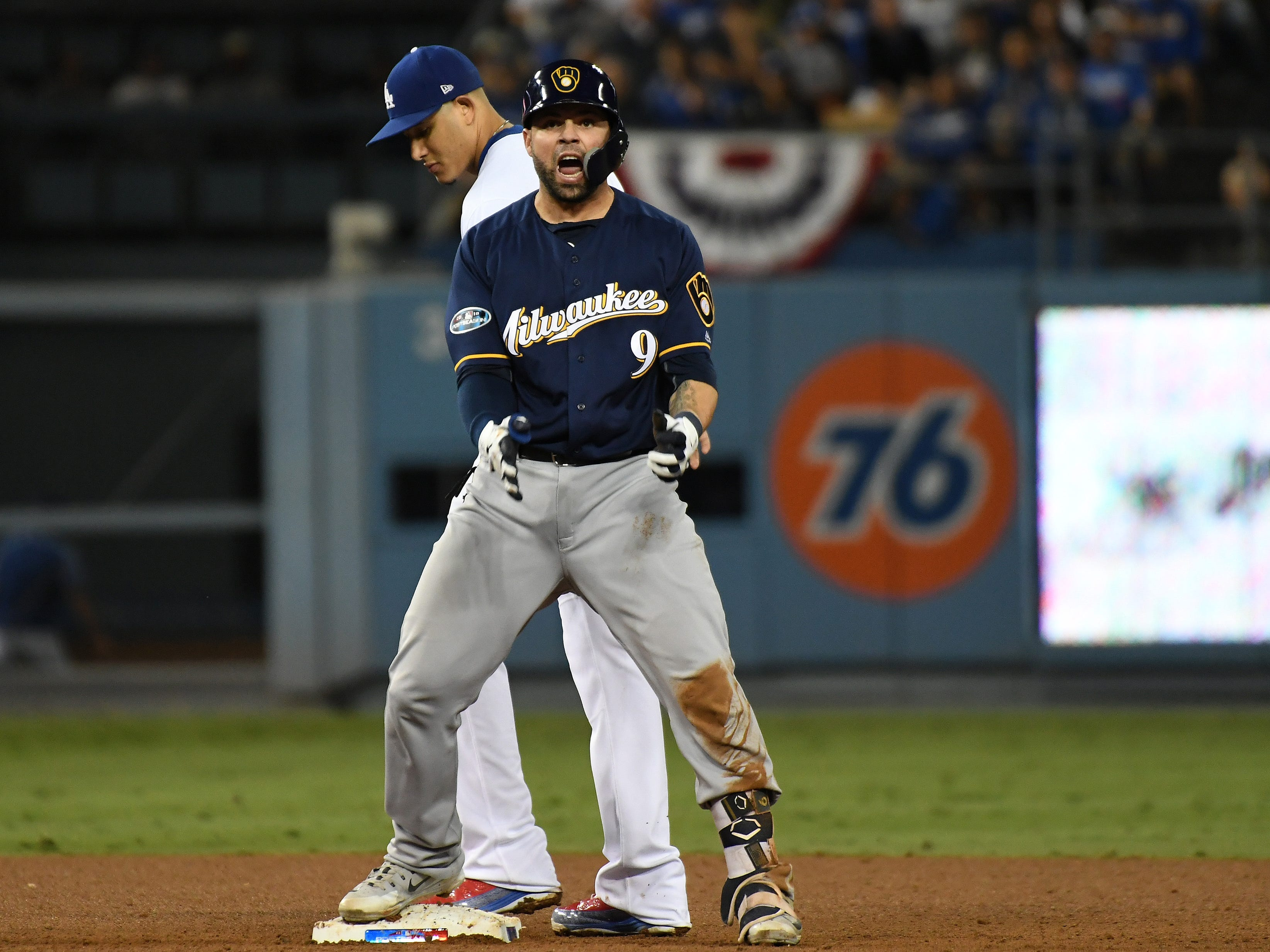 NLCS Game 4: Brewers catcher Manny Pina doubles in the seventh inning.
