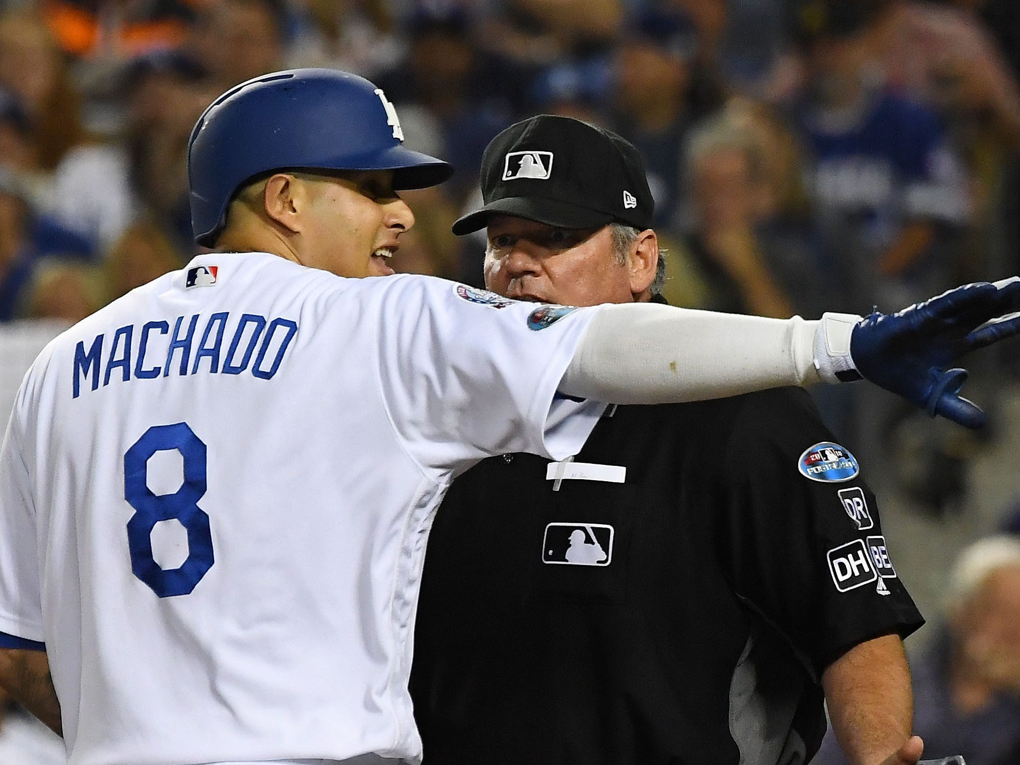 NLCS Game 4: Dodgers shortstop Manny Machado argues with home plate umpire Hunter Wendelstedt after striking out, claiming he called timeout before the pitch in the fifth inning.