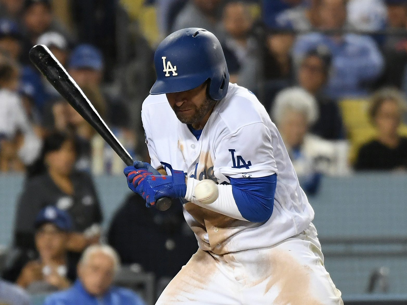 NLCS Game 4: Dodgers second baseman Brian Dozier is hit by a pitch in the sixth inning.
