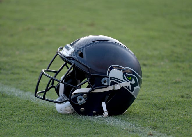 A detail shot of a Seattle Seahawks helmet on the field before a preseason game against the Los Angeles Chargers at StubHub Center.