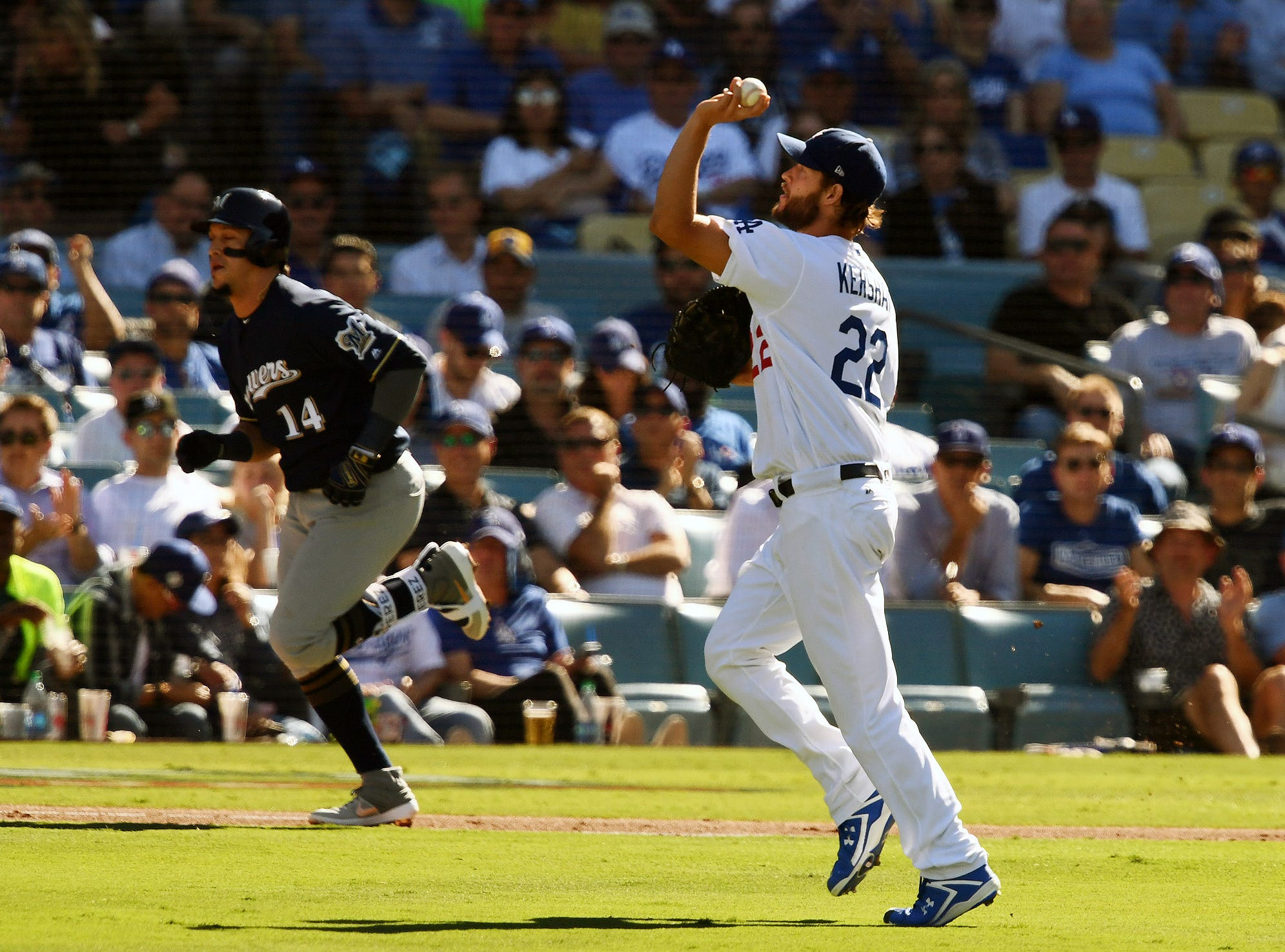 NLCS Game 5: Clayton Kershaw throws to first base for an out in the second inning.