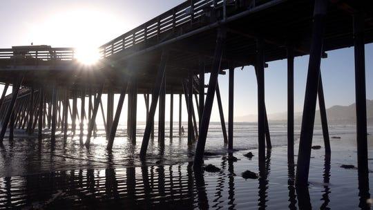 The sun glistens over the Pismo Beach Pier
