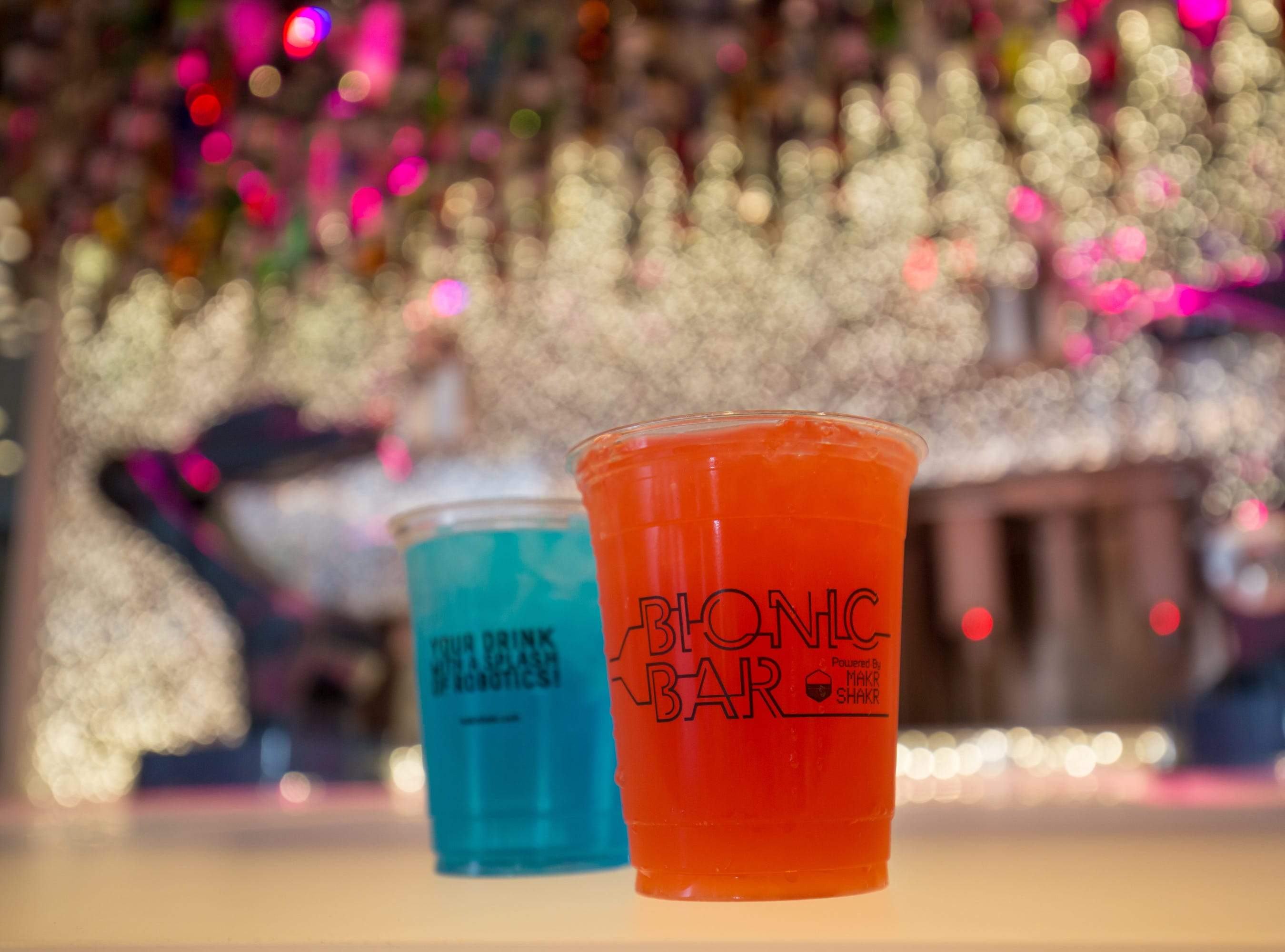 Ordering a drink at a Bionic Bar on a Royal Caribbean ship? Just don't expect it in a glass. The robot bartenders deliver drinks in plastic cups.