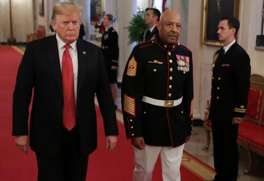 President Donald Trump and retired Marine Sgt. Maj. John L. Canley arrive at the East Room of the White House Oct. 17, 2018, in Washington, D.C.