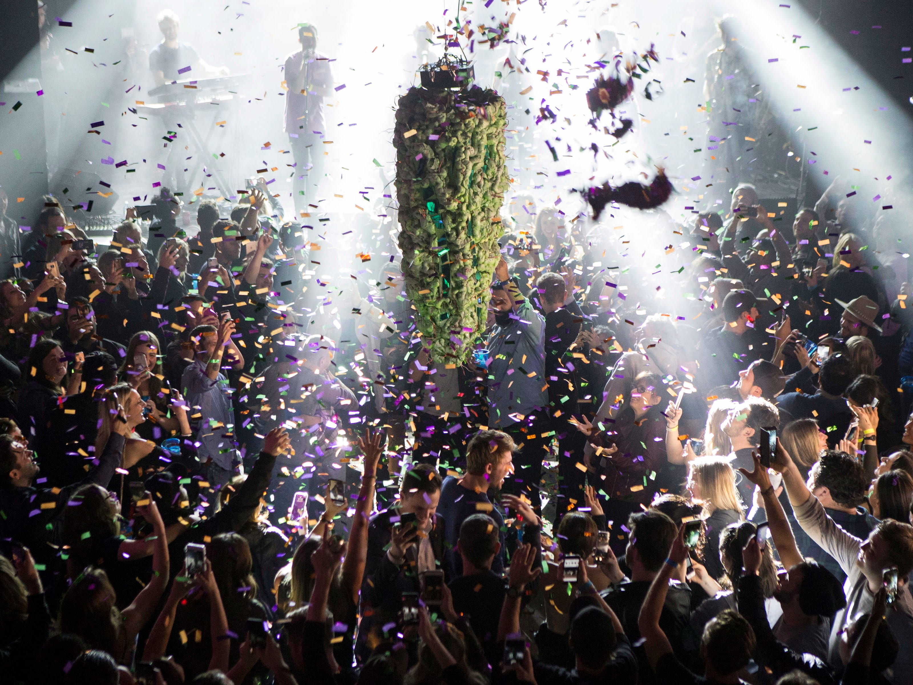 A depiction of a cannabis bud drops from the ceiling at Leafly's countdown party in Toronto on Wednesday, Oct. 17, 2018, as midnight passes and marks the first day of the legalization of cannabis across Canada. (Chris Young/The Canadian Press via AP) ORG XMIT: CHY110
