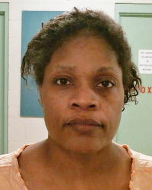 This photo provided by the Bolivar County Sheriff's Office shows Carolyn Jones, 48, who was taken into custody in Mississippi, Tuesday, Oct. 16, 2018. A sheriff says Jones has been charged with first-degree murder after her 20-month-old granddaughter, Royalty Marie Floyd, was found stabbed and burned inside an oven.