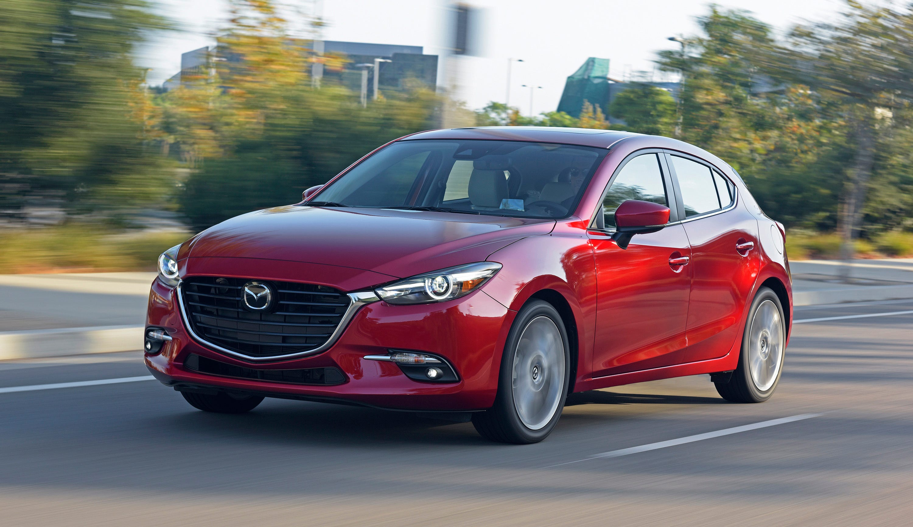 This undated photo provided by Mazda shows the 2018 Mazda 3. While the Civic is one of the most impressive vehicles in its class, it's not the only compact to offer buyers a little something extra. The Mazda 3 also sets itself apart with a well-appointed interior and sporty driving dynamics. (Morgan J Segal Photography/Mazda North American Operations via AP)