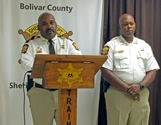 Bolivar County Sheriff Kelvin Williams, left, speaks to reporters at a news conference, Tuesday, Oct. 16, 2018, in Shaw, Miss., concerning a 20-month-old girl discovered dead in an oven.