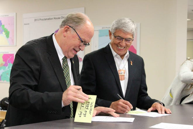 File - In this Aug. 20, 2018 file photo, Alaska Gov. Bill Walker, left, and Lt. Gov. Byron Mallott sign forms at the Division of Elections office in Anchorage, Alaska.