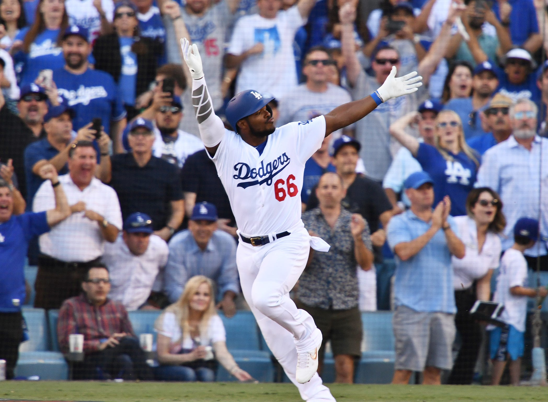 NLCS Game 5: Yasiel Puig celebrates his RBI single in the sixth inning.
