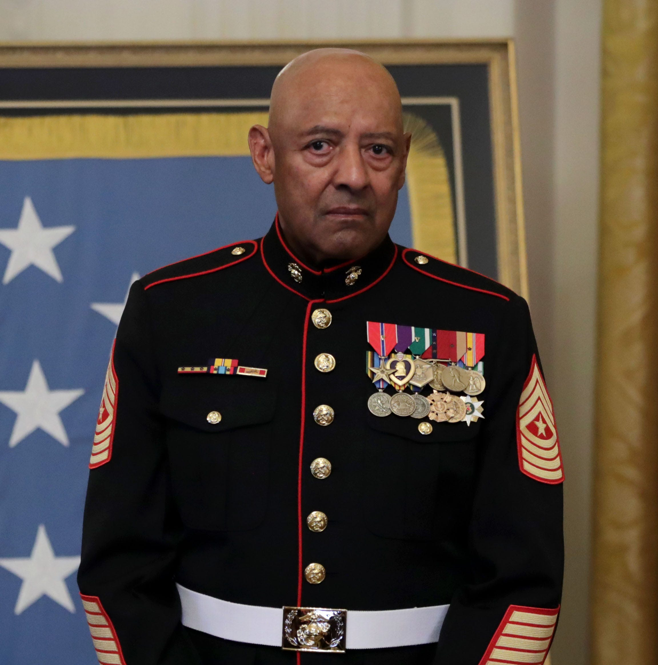 Retired Marine Sgt. Major John L. Canley is honored during a ceremony in the East Room of the White House October 17, 2018 in Washington, D.C.