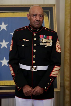Retired Marine Sgt. Maj. John L. Canley is honored during a ceremony in the East Room of the White House Oct. 17, 2018, in Washington, D.C.