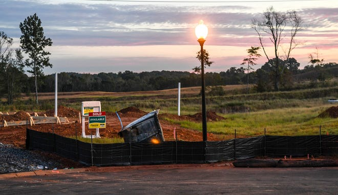 A sign declaring a lot with home to be built as sold, D.R. Horton company builds homes in the Rogers Knoll subdivision in October.  The homes are in the Anderson School District 1 area, a half mile from I-85, off of Rogers Road in Pelzer.