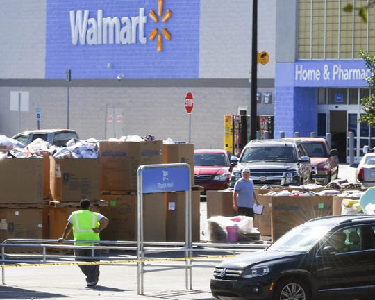 Employees from Walmart on S.C.28 bypass help restock and remove items as the store opened Thursday morning.