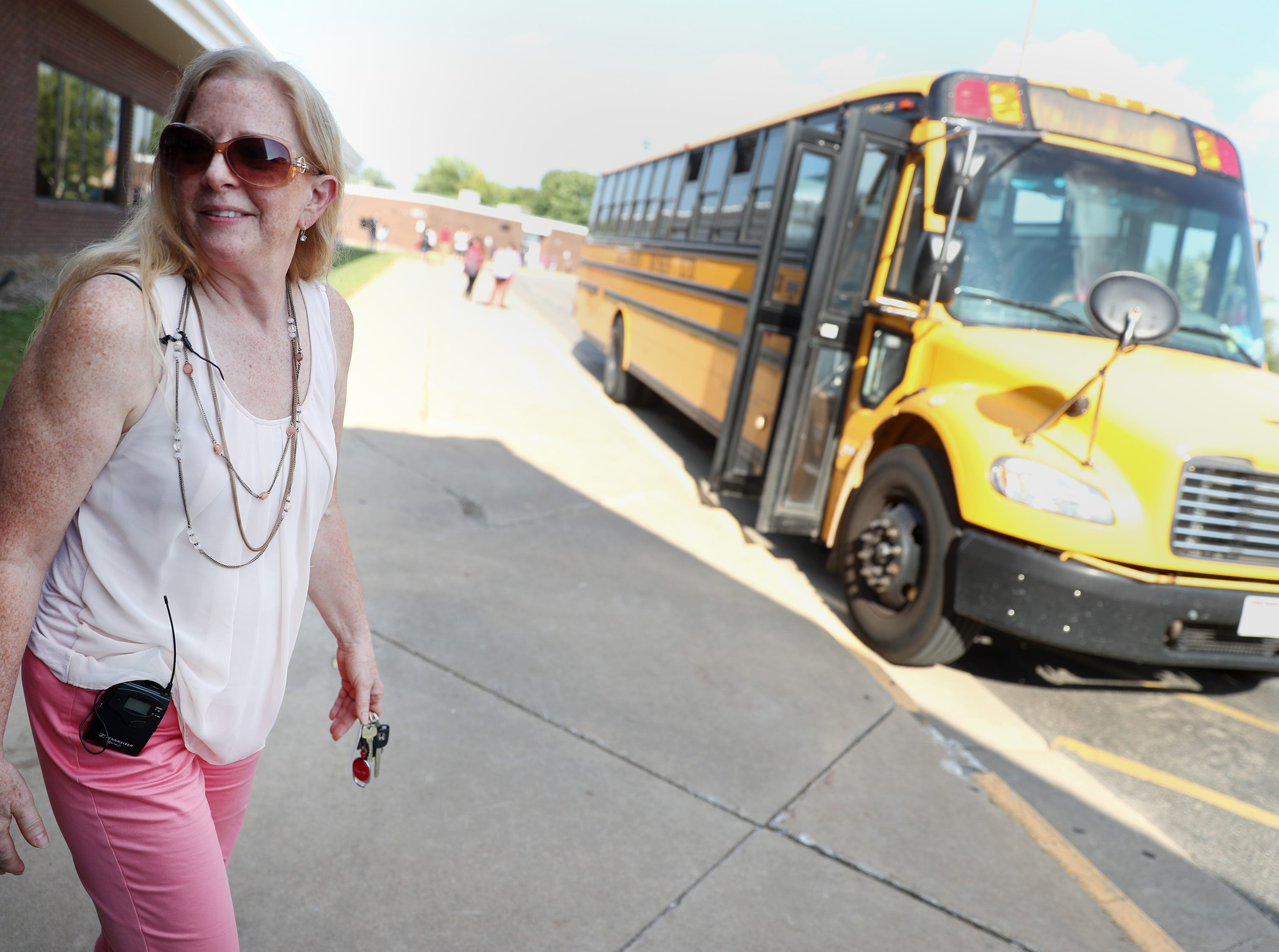 Maripat Franke, a special education teacher at Neenah High School currently enrolled in the Residency In Teacher Education 2.0 program at CESA 6, stands outside Neenah High School while working bus duty at the end of the day Monday, Sept. 17, 2018, in Neenah, Wis.