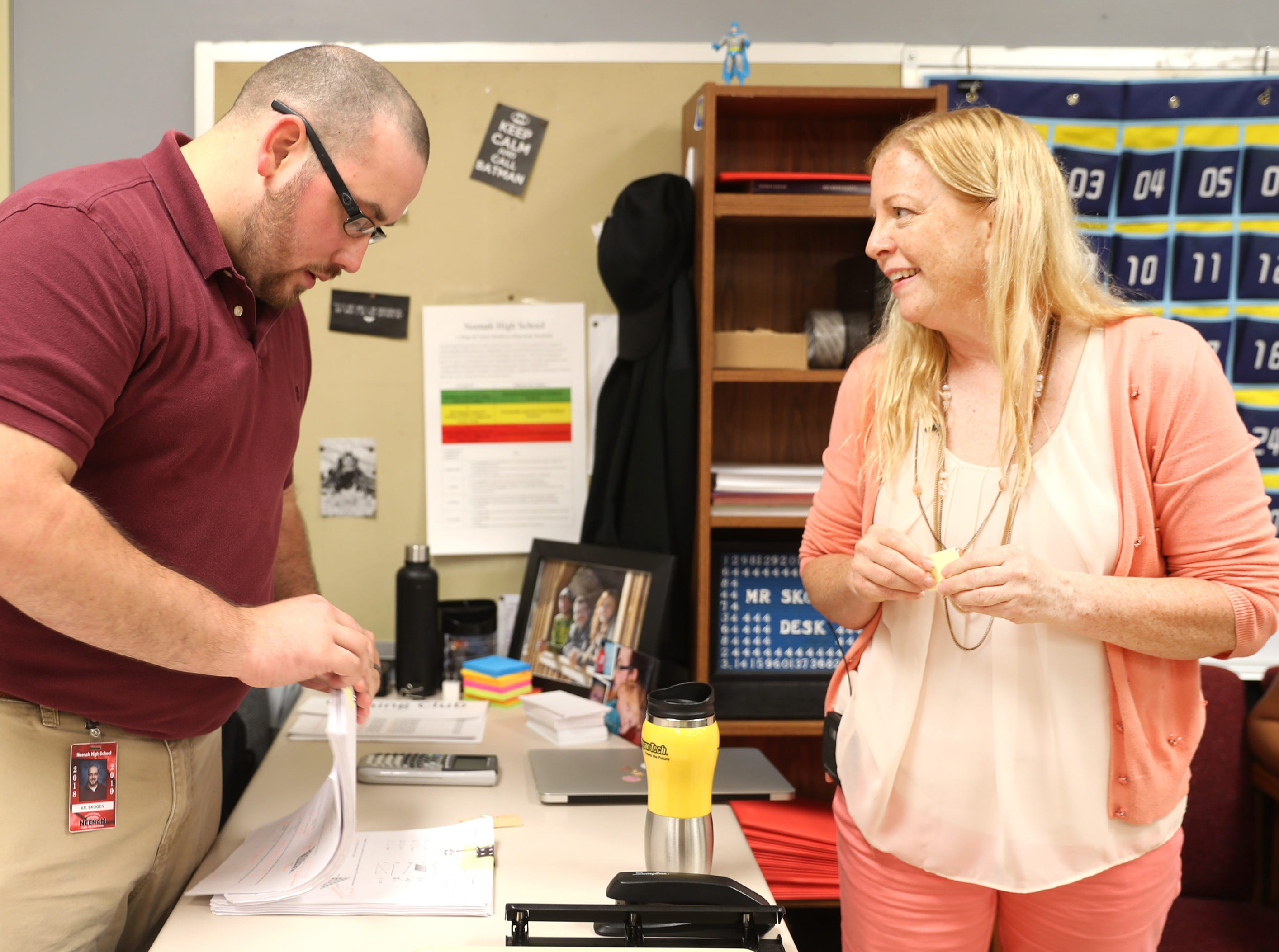 Chris Skogen, a math teacher at Neenah High School, prepares a stack of tests with Maripat Franke, a special education teacher currently enrolled in the Residency In Teacher Education 2.0 program at CESA 6, Monday, Sept. 17, 2018, in Neenah, Wis. Skogen and Franke co-teach the class.