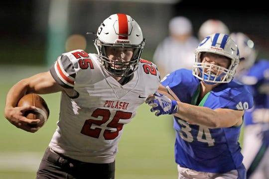 Pulaski's Dylan Hendricks (25) rushes against Green Bay Notre Dame in a game at Notre Dame Academy on Sept. 7.
