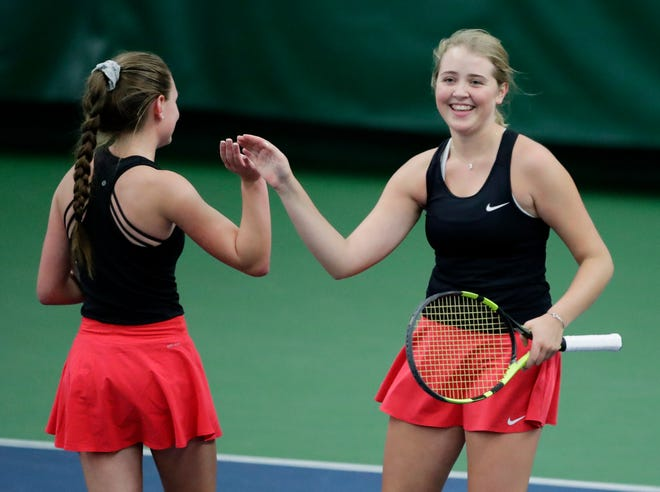 Neenah's Alex Van Zeeland high fives Ava Asbury during their first-round Division 1 doubles match at the state individual tennis tournament Oct. 11 in Madison.