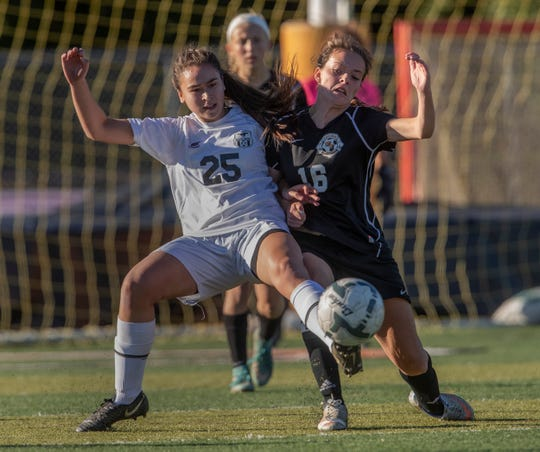 Marlboro's Victoria Tzitzis and Middeltown North's Emily McCarthy battle each other for ball during first half action. Middletown North Girls Soccer vs Marlboro in Shore Conference Tournament game in Middletown, NJ on October 18, 2018.
