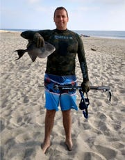Brian Cassidy, Red Bank, holds the new state record triggerfish, spearfish category.