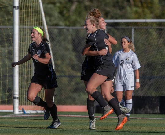 Middletown North's Darien Rinn celebrates with teammates after kicking  in goal past Marlboro's Sofia James for North's second goal of game. Middletown North Girls Soccer vs Marlboro in Shore Conference Tournament game in Middletown, NJ on October 18, 2018.