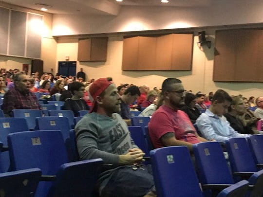 Some members of the crowd at the Toms River Regional school board meeting Wednesday wore red to show support for education.