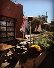 At Medusa Stone Fired Kitchen, enjoy a pizza and a bowl of soup at an outdoor table.
