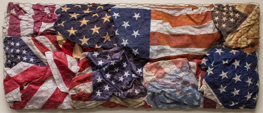 """M.I.A."" by Bernie Taupin, a piece from the ""True American"" exhibition on display at Chase Contemporary."