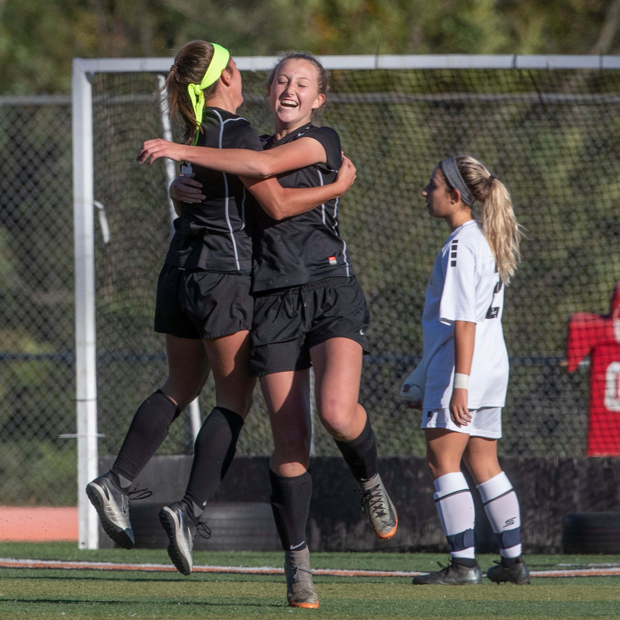 Middletown North's Darien Rinn celebrates with team mates after kicking  in goal past Marlboro's Sofia James for North's second goal of game. Middletown North Girls Soccer vs Marlboro in Shore Conference Tournament game in Middletown, NJ on October 18, 2018.