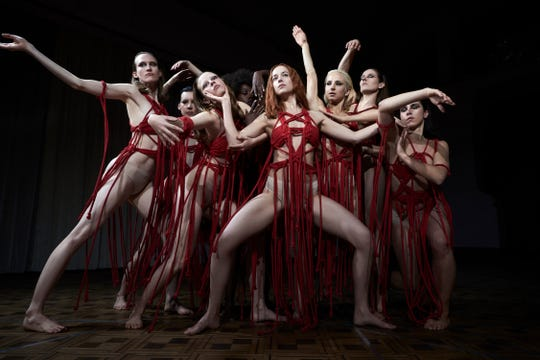 "Mia Goth as Sara, third from left, and Dakota Johnson as Susie, center, star in ""Suspiria."""