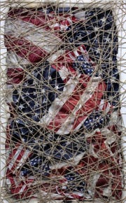 """Prisoner of War"" by Bernie Taupin, a piece from the ""True American"" exhibition on display at Chase Contemporary in New York City."