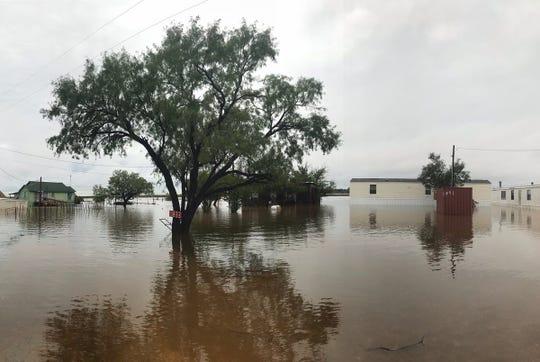 Areas around Lake Stamford remain flooded on Thursday.