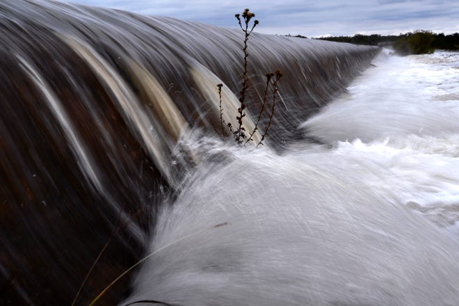 Floodwaters rush over the service spillway at Lake Fort Phantom Hill Thursday.