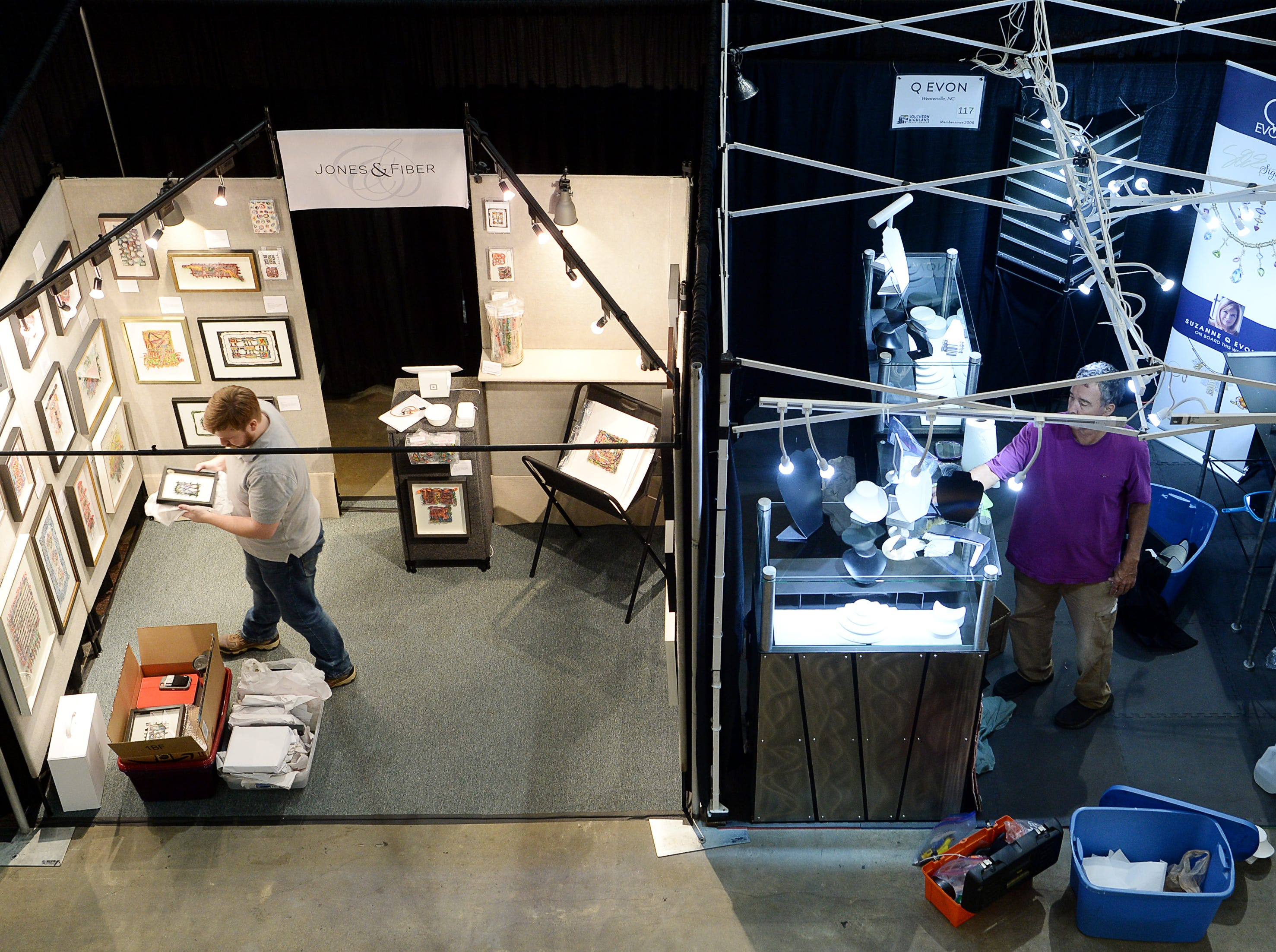 Artists prepare their booths for the Craft Fair of the Southern Highlands at the US Cellular Center Oct. 18, 2018.