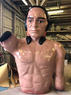 The Chief Pontiac statue that stood at the Harry's on the Hill car dealership for 50 years, recently got a major restoration. Mark Cline of Enchanted Castle Studios in Natural Bridge, Virginia did the restoration work.