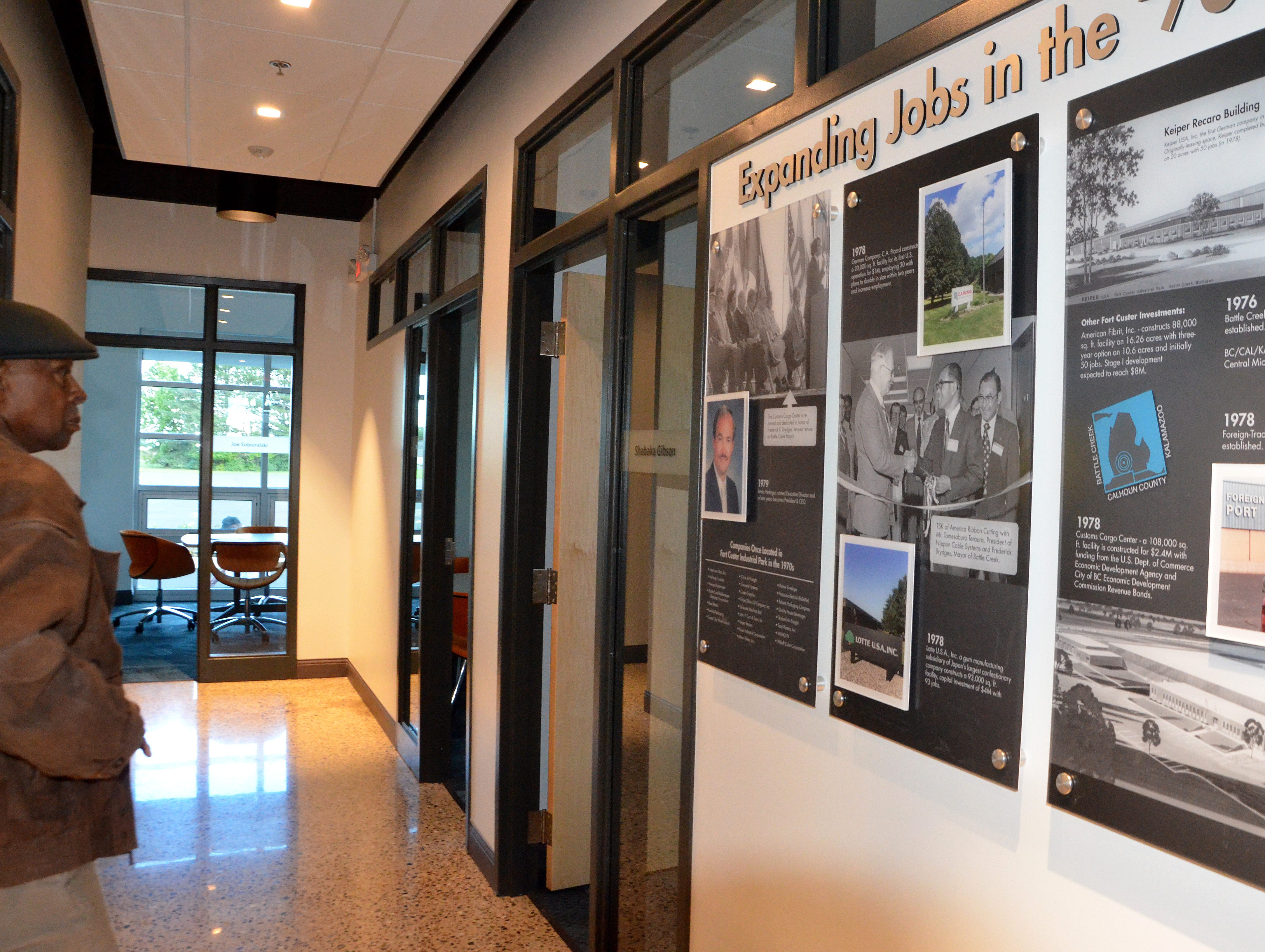 The walls of Battle Creek Unlimited's new office space have been decorated with six panels detailing Battle Creek Unlimited's history from 1969 through 1979. Panels for the years after that to now will be added over time.