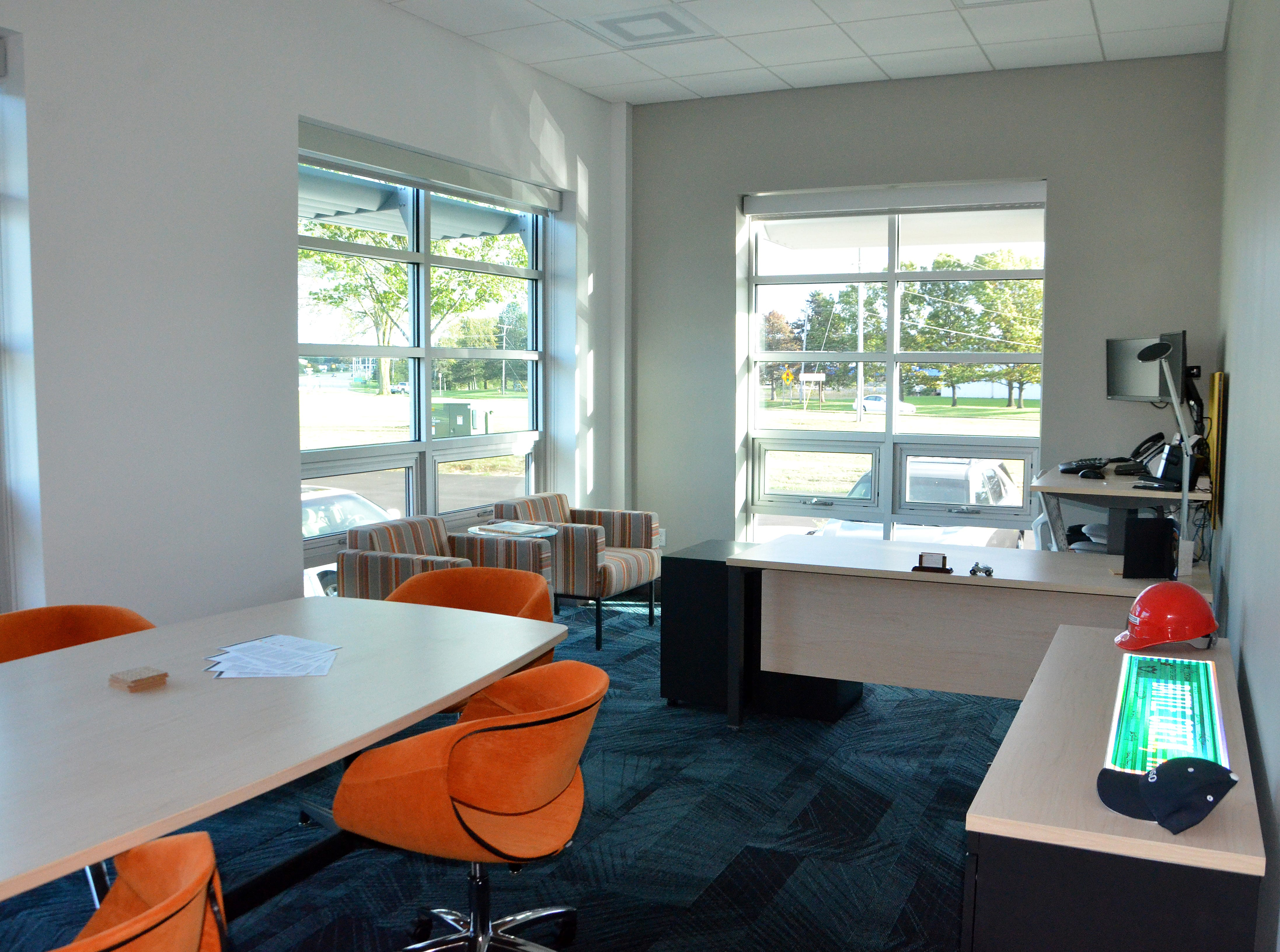 Battle Creek Unlimited's new office space has a white, tan, orange and blue color scheme.