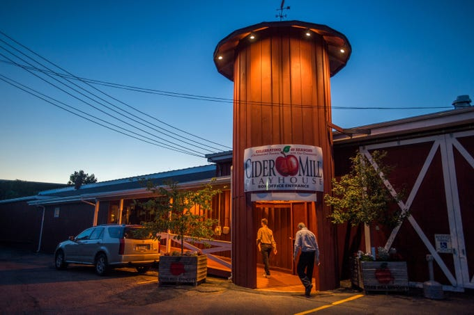 "Theater-goers enter the Cider Mill Playhouse for a performance of ""When in Carthage"" on Sept. 22, 2016."