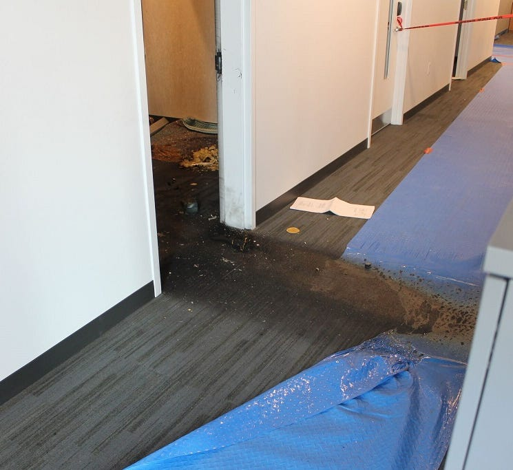 A crime scene investigation photo of the doorway leading to the office where Josie Berrios was killed in an intentionally set fire in June 2017 at a Collegetown building in Ithaca.