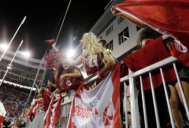 Washington State fans cheer during the second half of the Cougars' Sept. 9 win over Boise State in Pullman.