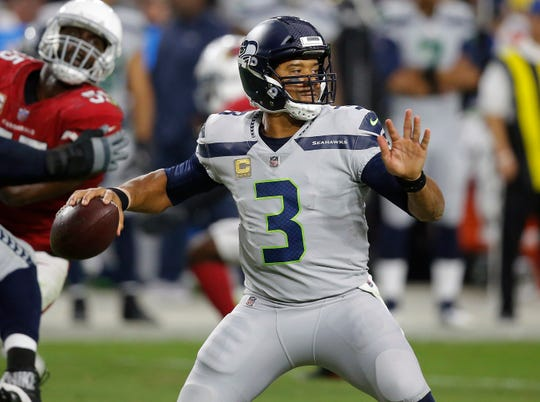 """Seahawks coach Pete Carroll says quarterback Russell Wilson is """"doing more than ever before,"""" even though he's running less than he typically has."""